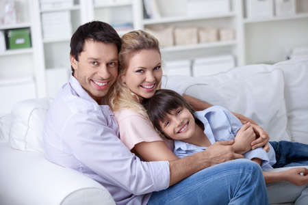A happy family with a child at home photo