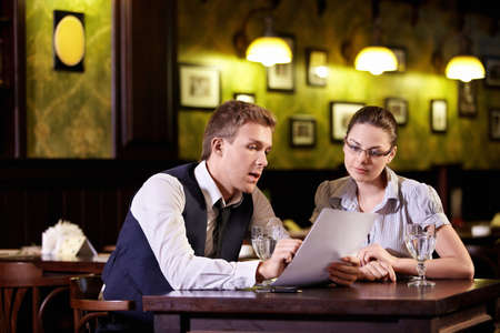 Young people are discussing in the restaurant photo