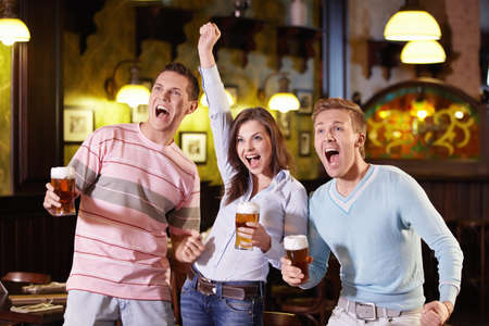 Young people enjoyed a victory in the pub Stock Photo - 9997046