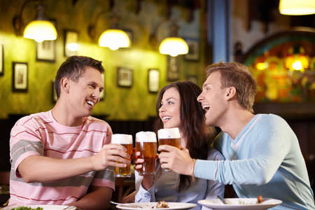 Young people with a beer in a restaurant photo