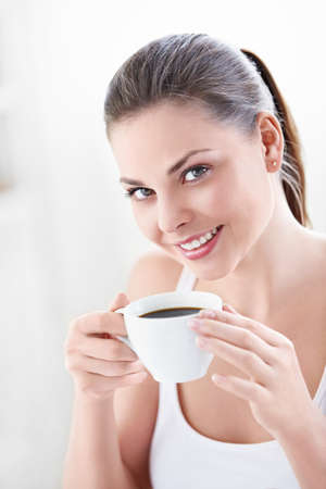 A beautiful girl with a cup of coffee Stock Photo - 10259516