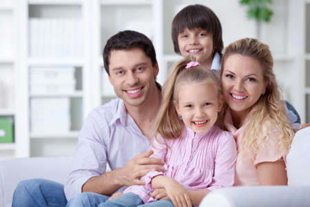 4 people: Happy family with children at home Stock Photo