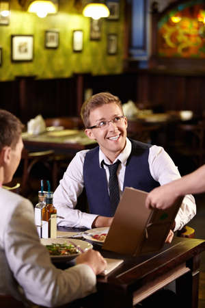 Young men in a restaurant photo