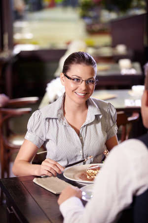 Young attractive couple in a restaurant photo