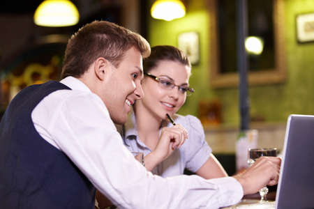 Young people with a laptop in a restaurant photo
