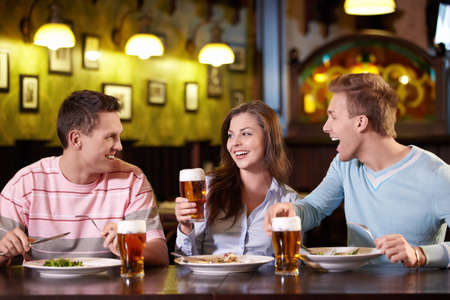 social drinking: Young people have dinner at a restaurant