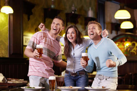 beer in bar: Young people are expressing in the pub