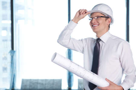 A young man in a shirt and a helmet on a construction site Stock Photo - 10259467