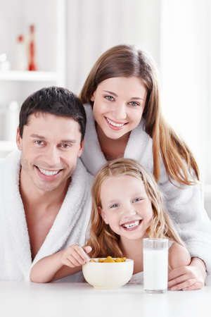 Young family with a child in the kitchen Stock Photo