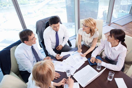 negotiation business: Business people are discussing in the office