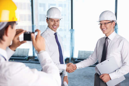 A man photographed handshake business partners in construction photo