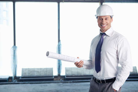 A man in a helmet on a construction site