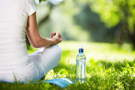 the wellbeing: Woman in lotus position close-up