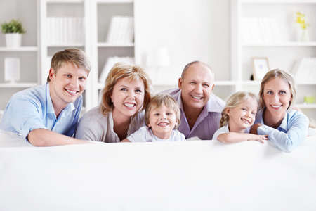 family at home: Happy big family with children at home