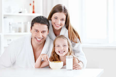 cornflakes: Happy family in the kitchen Stock Photo