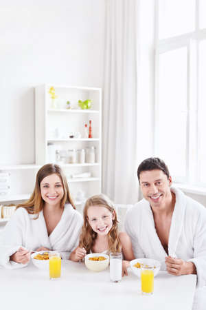 Family with a child has breakfast photo