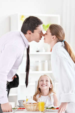 Kissing couple in the kitchen photo
