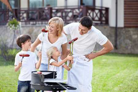 white sausage: Family eating sausages in the open air Stock Photo