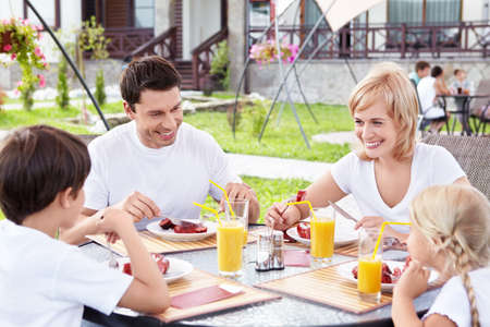 outdoor eating: A happy family for a meal