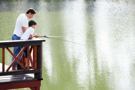 Father and son go fishing photo