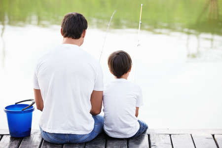 man fishing: Father and son go fishing