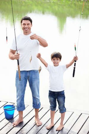 dad and son: Father and son show catch
