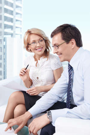 mature male: Smiling business people in office