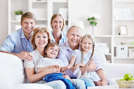 Smiling family at home photo