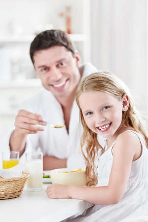 Father and child in the kitchen photo