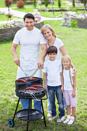 Families with children make barbecue photo