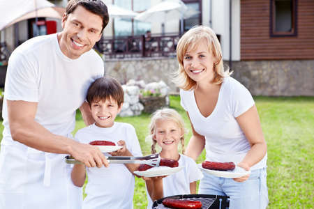 Smiling family with children at barbecue photo