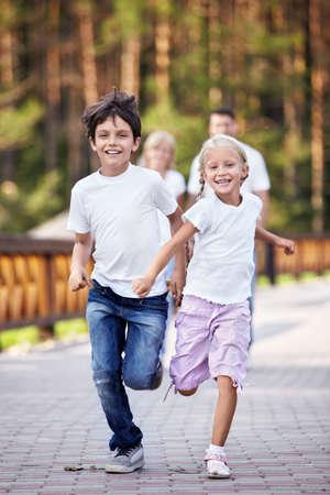 children running: Running happy kids outdoors Stock Photo