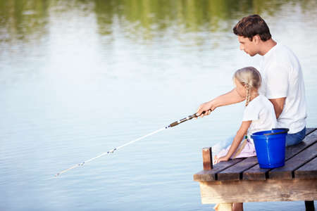 Father and daughter fishing photo