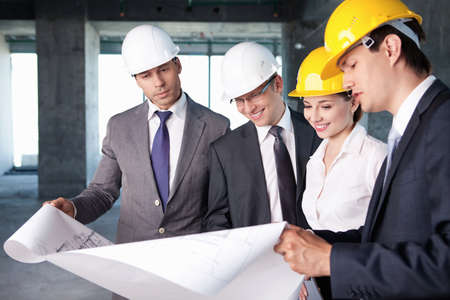 building safety: Business people at a construction site Stock Photo