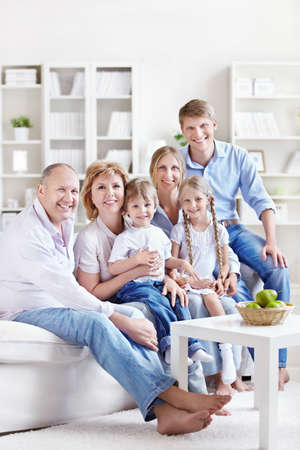 A large family with children and grandchildren at home photo