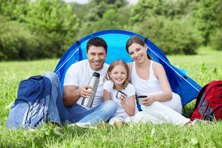 Happy family outdoors in a tent photo