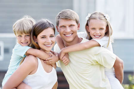 Smiling family with children outdoors photo
