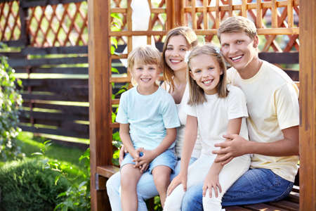 arbor: Smiling family in the gazebo outdoors