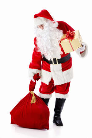 Santa Claus with a bag and a gift on a white background photo