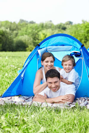 A young family with a tent photo