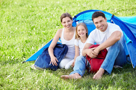 A young family with a child and a tent photo