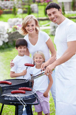 Families with children on a barbecue photo