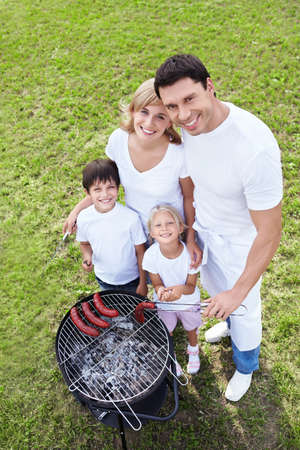 barbecue party: Happy families on a barbecue Stock Photo