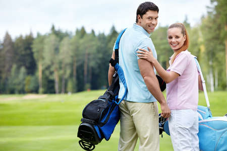 Young couple on the golf course Stock Photo - 11021575