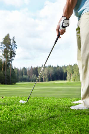 golfers: The man with the club playing golf Stock Photo