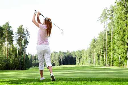 woman golf: Young girl playing golf Stock Photo