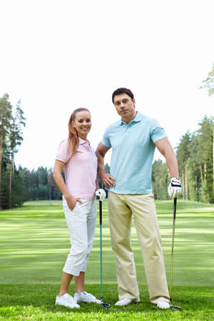 The happy couple on the golf course photo