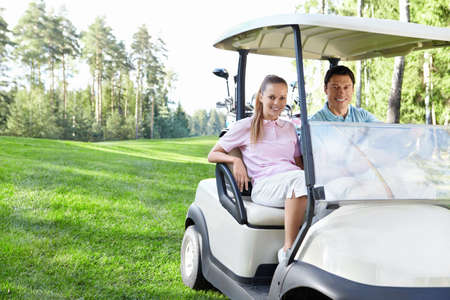 Young couple in the car for golf photo
