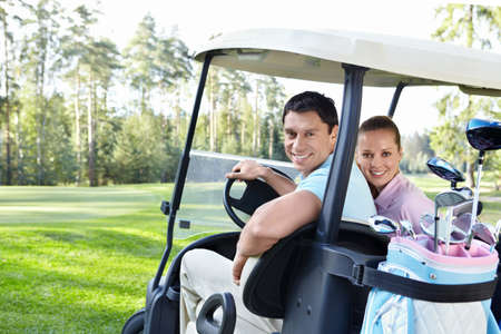 Young couple in the car for golf Stock Photo - 11021573