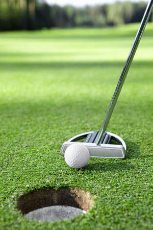 putter: Stick pushes the ball in the hole